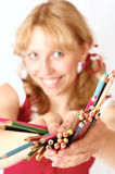 The girl and pencils Stock Image