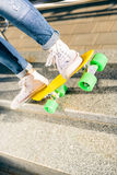 Girl with penny skateboard shortboard. Stock Photography