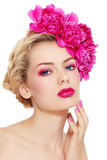 Girl with peonies Stock Images