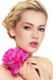 Girl with peony Stock Photos