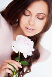 Girl with peony flower Royalty Free Stock Image