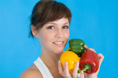 Girl with pepper Stock Images