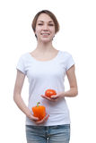 Girl with pepper and tomato in her hands Royalty Free Stock Images
