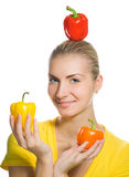 Girl with peppers Royalty Free Stock Photos