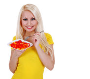 Girl with peppers salad, blonde young woman eating healthy isolated Stock Photo