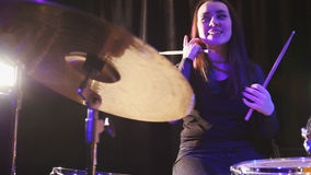 Girl percussion drummer performing with drums. Telephoto stock photography