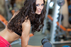 Girl with perfect body in fitness hall Royalty Free Stock Photos