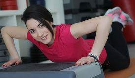Girl with perfect body in fitness hall royalty free stock photo