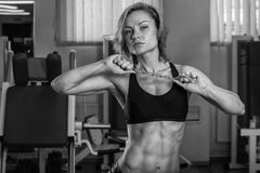 Girl with perfect body in the gym Royalty Free Stock Photos