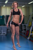Girl with perfect body in the gym Royalty Free Stock Photo