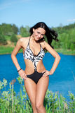 Girl with perfect body on the lake Stock Photography