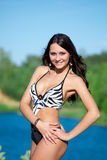 Girl with perfect body on the lake Stock Images