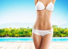 Girl with a perfect body shape resting on a summer vocation Stock Images