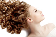 Girl with perfect curls Stock Photos