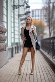 Girl with perfect legs in pantyhose at the city square. royalty free stock photos