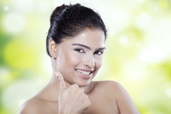Girl with perfect skin giving thumb up Royalty Free Stock Image