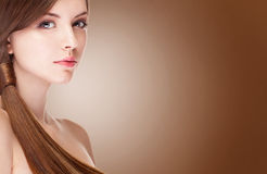 Girl with perfect skin over brown background Royalty Free Stock Photos