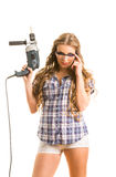 Girl with a perforator Stock Image