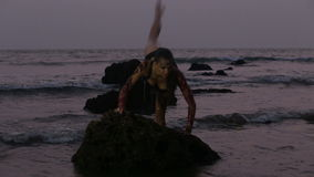 Girl Performers dance acrobatic stunts in the water stock video footage
