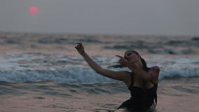 Girl Performers dance acrobatic stunts in the water stock video