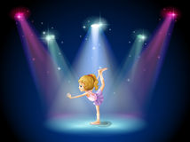 A girl performing ballet on the stage with spotlights Royalty Free Stock Images