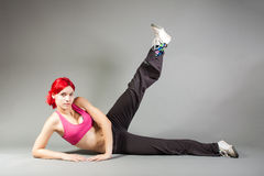 Girl performing exercises. Portrait of a girl performing exercises royalty free stock photos