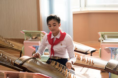 Girl performing an instrument in North Korea Royalty Free Stock Images