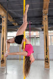 Girl performing pole dance Stock Images