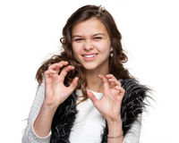 Girl performing a scratching gesture royalty free stock images