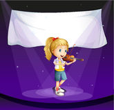 girl performing at stage with an empty banner Royalty Free Stock Photo