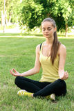 A girl performs exercises of yoga stock photos