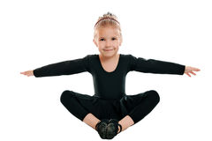 Girl performs gymnastic exercise Royalty Free Stock Image