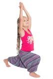 Girl performs gymnastic exercise Stock Photos