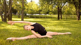 Girl performs gymnastic exercises in nature stock footage