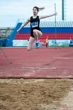 Girl performs a long jump Royalty Free Stock Photos