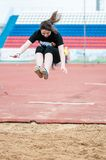 Girl performs a long jump Royalty Free Stock Photography