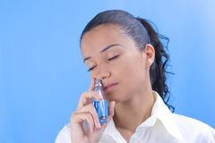 Girl with perfume. Young pretty girl holding perfume Stock Photos