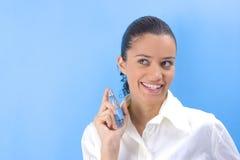 Girl with perfume. Young pretty girl holding perfume Stock Image