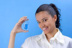Girl with perfume. Young pretty girl holding perfume Stock Images