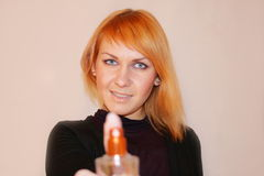 The girl with perfume. The beautiful young girl with perfume royalty free stock images