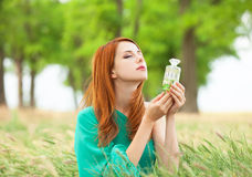Girl with perfume Stock Photo