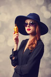 Girl with perfume Stock Image