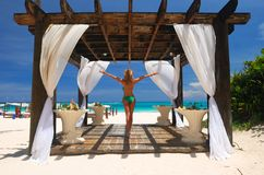 Girl in pergola. Beautiful caribbean beach with pergola in Dominican Republic Royalty Free Stock Image