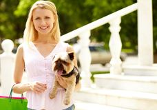 Girl with pet Stock Images