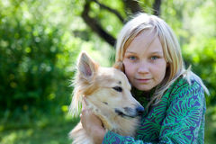 Girl with pet dog Stock Photo