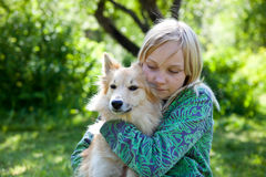 Girl with pet dog Stock Photography