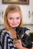 Girl with Pet Dog. Pretty girl holding her pet chihuahua dog Royalty Free Stock Photography