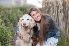 Girl with pet dog. Hugging stock photos