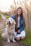 Girl with pet dog. Sitting on ground stock photos