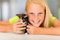 Girl pet friend. Preteen girl with her pet friend closeup portrait Stock Image